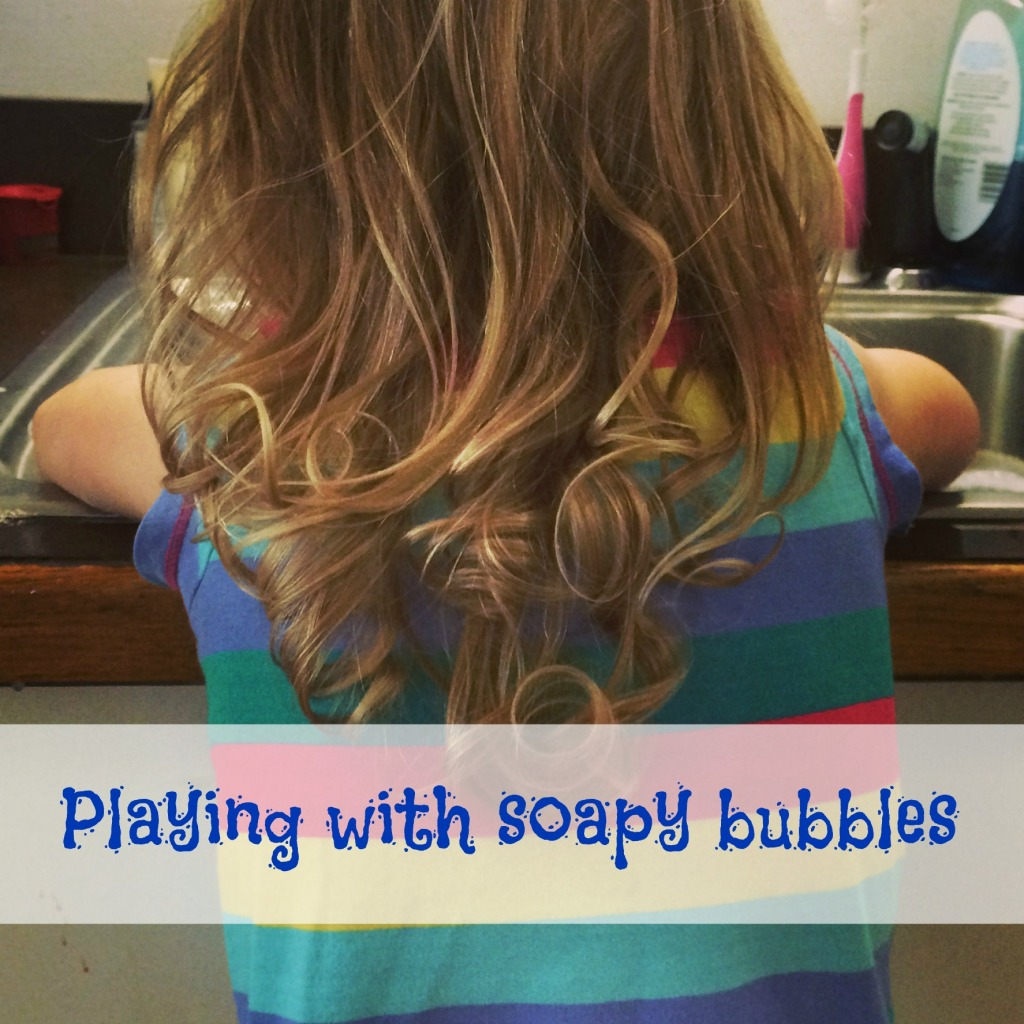 Playing with soapy bubbles